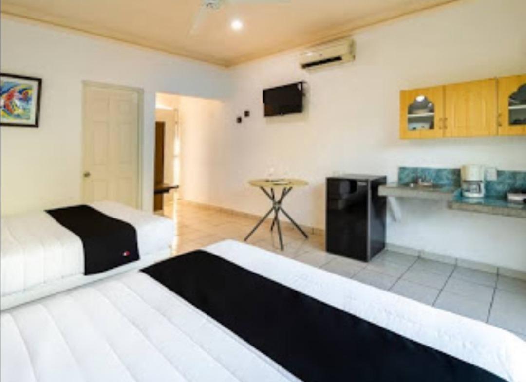 Habitación con cocineta pago extra $200 por noche